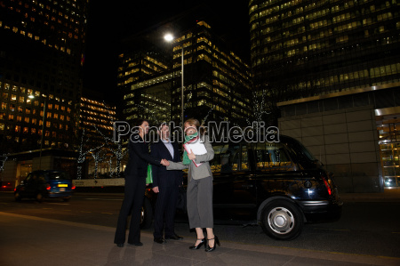 business trio with taxi and office