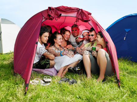 group of people in tent