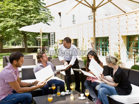men and women talking over menus