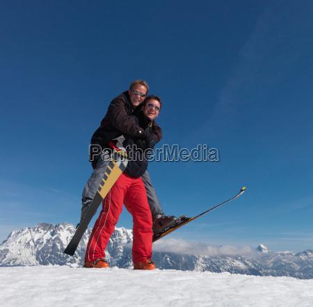 skiers playing piggyback ride
