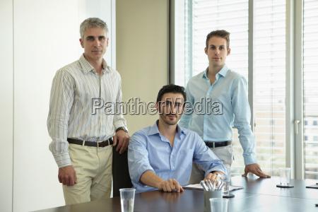 portrait of three business men