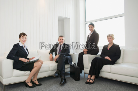 a portrait of four business people