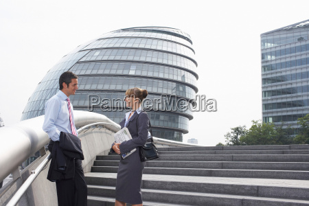 two office workers outside talking