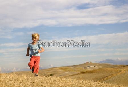 boy running across field