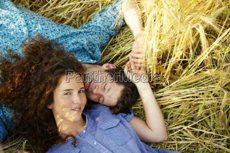 couple, laying, down, in, a, wheat - 18308726