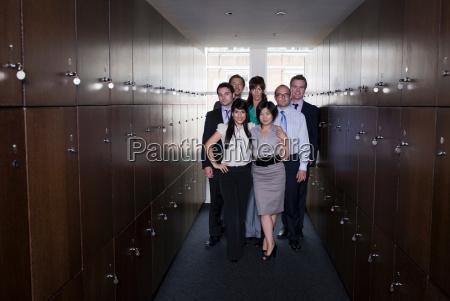 business people in locker room portrait