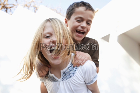 boy and girl smiling at camera