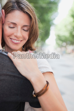couple embracing in the street