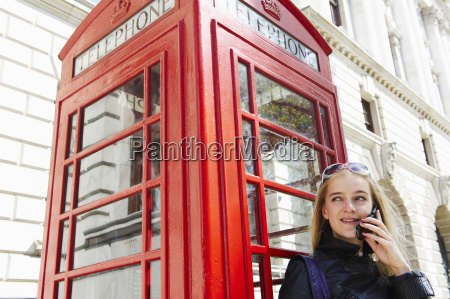 woman next to phone booth on
