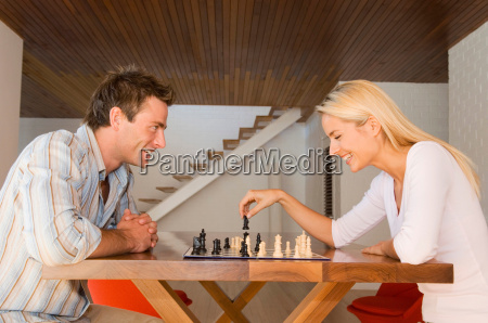 couple playing chess together