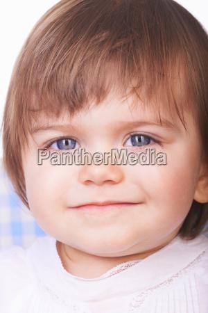 close up of baby girls smiling