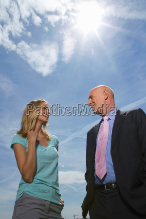 business people talking outdoors