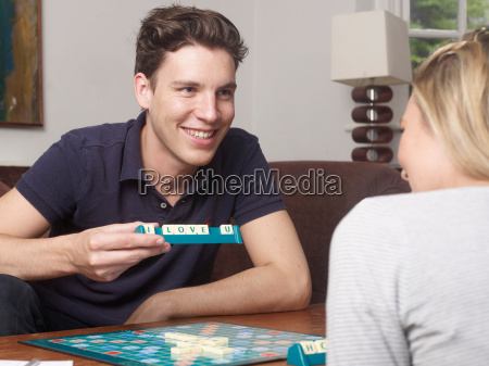 couple playing scrabble together