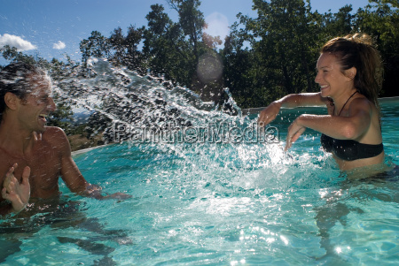 couple playing with water in the