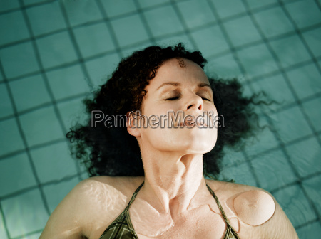woman lying in water close up