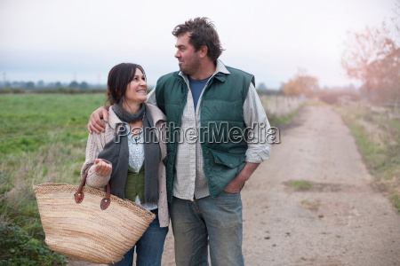 couple walking in country lane