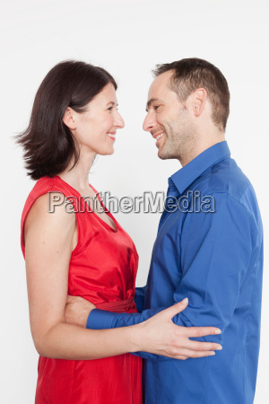 couple embracing each other smiling