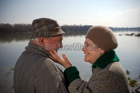 senior couple woman touching mans face
