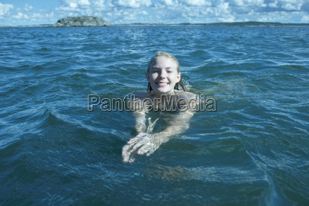 young woman swimming in the sea