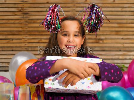 girl 8 10 holding birthday present