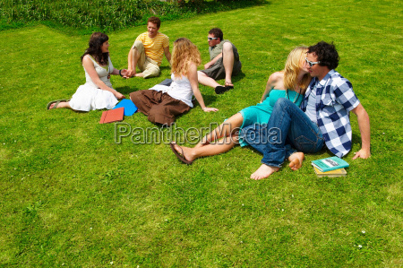 group of young people sitting on