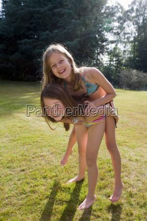 girl piggyback on another girl