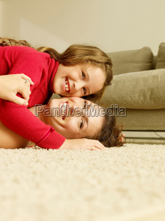 mom and girl on floor looking