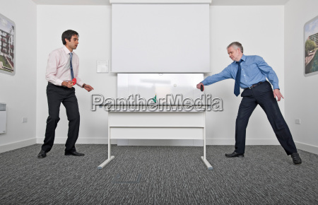 business men playing table tennis