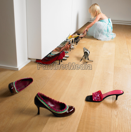 girl lining up her mothers shoes