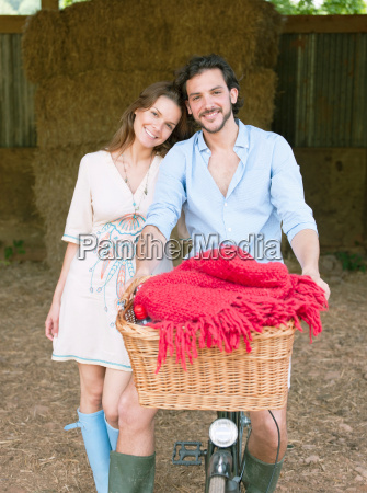 couple in on bike with picnic