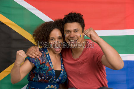 couple smiling with south african flag