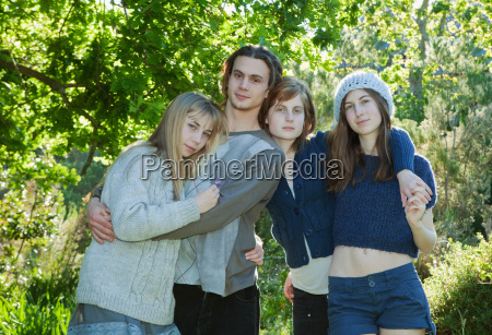 young adults with arms around each