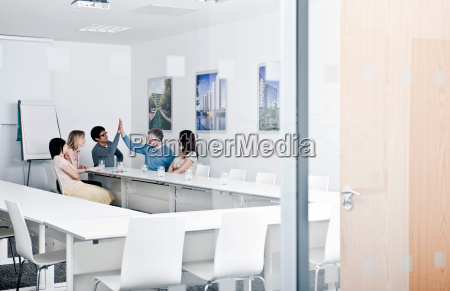relaxed work group in meeting room