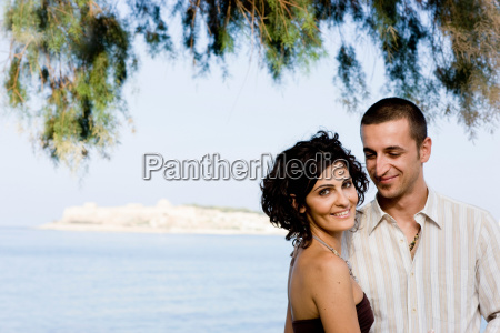 couple smiling together on waterfront