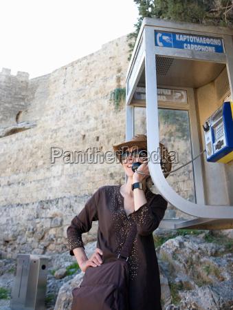 woman on phone in phone box
