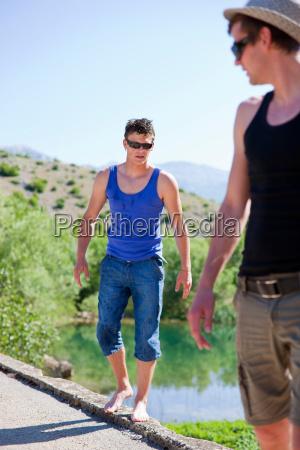 men walking on rural road