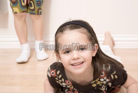 girl on floor girl standing behind