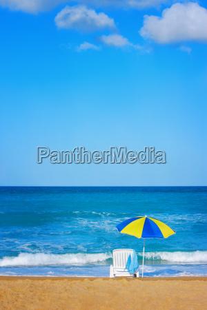 beach umbrella on a deserted beach