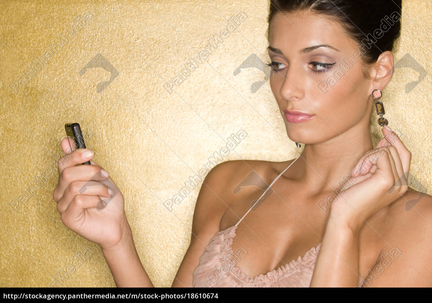 a, woman, using, a, cell, phone - 18610674