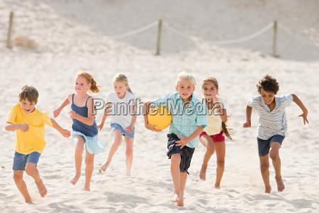 children running across beach