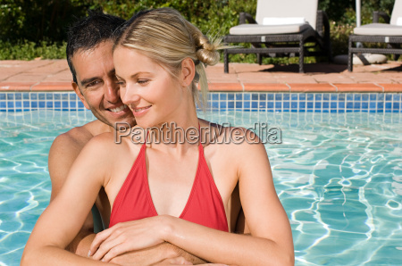 a couple in a swimming pool