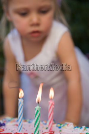 girl and birthday candles