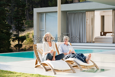 middle aged couple relaxing on deck