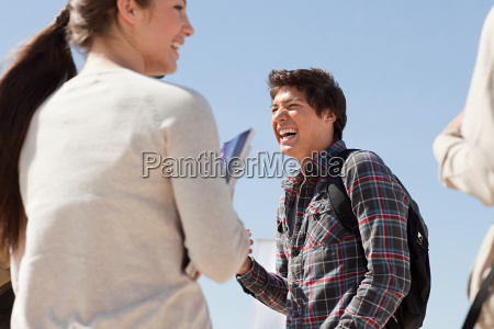 high school students talking and laughing