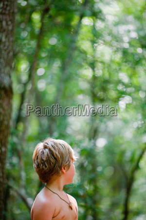 boy in forest looking away