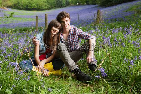 young couple in a field of