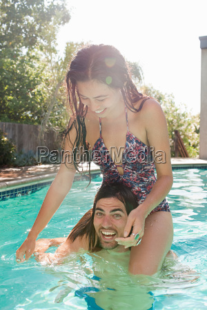 young woman on young mans shoulders