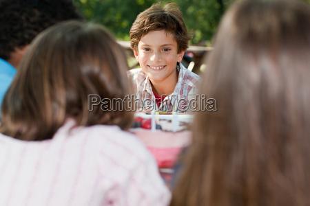 boy at birthday party eating birthday