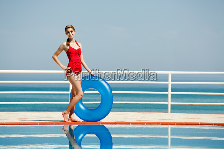 young woman with inflatable ring by