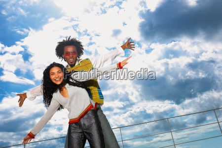 man and woman with cloudy sky